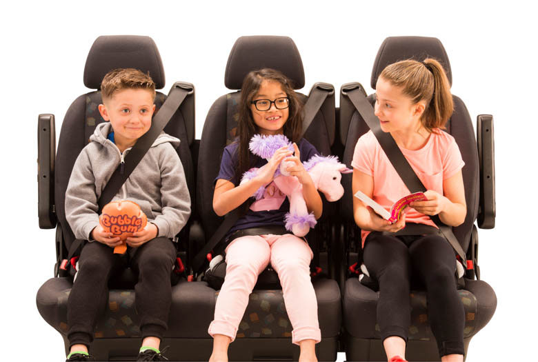 3 children sat on BubbleBum booster seats across the back seat of a car - black design