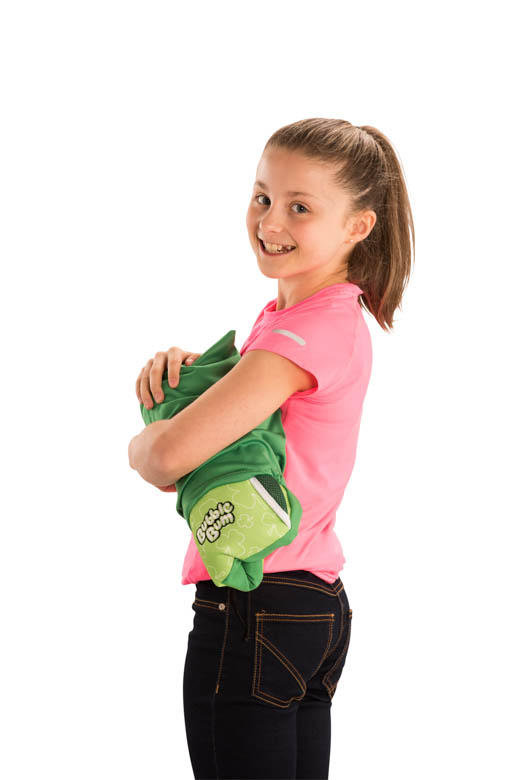 Girl holding shamrock BubbleBum car booster seat under arm in carry bag