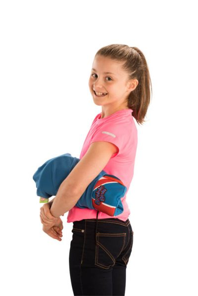 Girl holding BubbleBum car booster seat under arm in carry bag