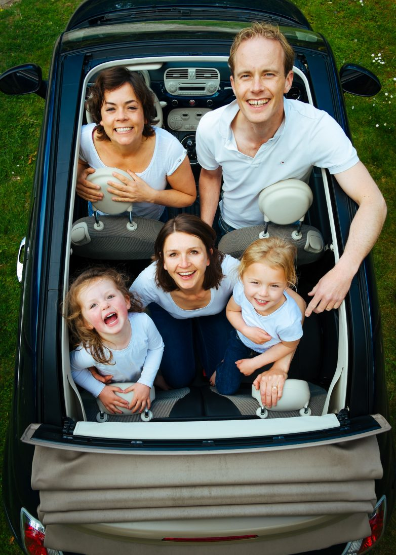 Family Group In An Open Top Car