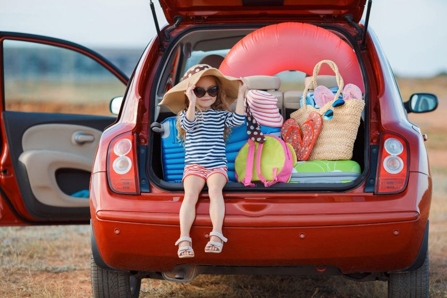 Child in the boot of the car with the hatchback open